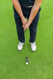 Golf player with club. Golf player holding club, ready to hit ball Stock Photos
