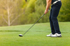 Golf player with club. Golf player holding club, ready to hit ball Royalty Free Stock Images