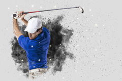 Golf Player coming out of a blast of smoke Stock Photos