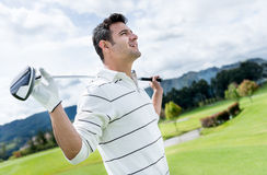 Golf player at the course Royalty Free Stock Photo