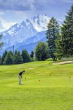 Golf player, Crans-Montana, Switzerland Royalty Free Stock Images