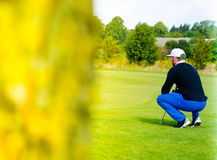 Golf player estimating distance Stock Photos