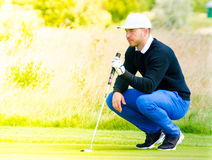 Golf player estimating distance Stock Photo