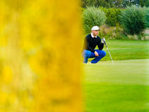 Golf player estimating distance Royalty Free Stock Photography