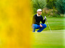Golf player estimating distance Royalty Free Stock Image