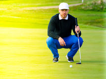 Golf player estimating distance Royalty Free Stock Images