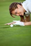 Golf player flicking the ball Stock Images