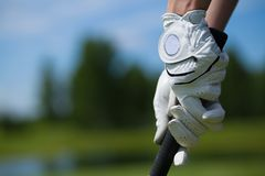 Golf player gloves hold the iron or putter. Golf player white gloves hold the iron or putter in right pose stock photos
