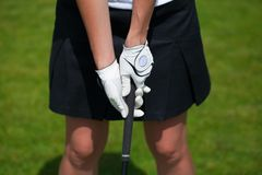 Golf player gloves hold the iron or putter. Golf player white gloves hold the iron or putter in right pose stock photo