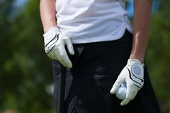 Golf player gloves hold the iron or putter. Golf player white gloves hold the iron or putter in right pose royalty free stock images