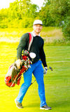 Golf player with golf bag Stock Photo