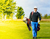 Golf player with golf bag Stock Images