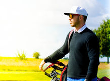 Golf player with golf bag Royalty Free Stock Photography