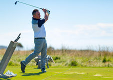 Golf player on the golf field. Cape Kidnappers golf court. New Zealand. Royalty Free Stock Image