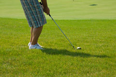 Golf player on green Royalty Free Stock Photo