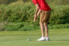 A golf player on a green. In France Stock Photography