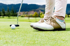Golf player at the green Stock Photo