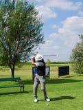 Golf player hit ball Stock Photos