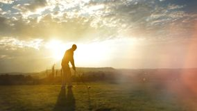 Golf player hits golf ball