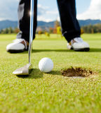 Golf player hitting the ball Royalty Free Stock Image