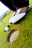 Golf player hitting the ball Stock Image