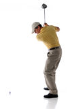 Golf Player Hitting Ball. Studio shot of golfer hitting the ball isolated over a white background Stock Images