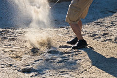 Golf player hitting the ball from the sand bunker stock images
