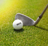 Golf player hitting the ball into the whole Stock Images