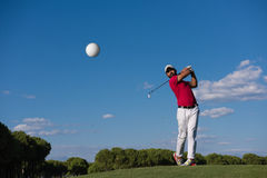 Golf player hitting long shot Royalty Free Stock Photography