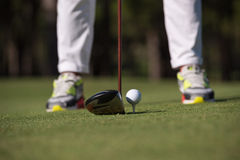 Golf player hitting shot. With club on course at beautiful morning royalty free stock photography
