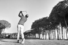 Golf player hitting shot with club Royalty Free Stock Images