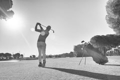 Golf player hitting shot with club Royalty Free Stock Photo