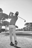 Golf player hitting shot with club Royalty Free Stock Image
