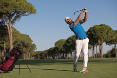 Golf player hitting shot Stock Photo