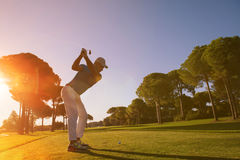Golf player hitting shot with club Royalty Free Stock Photos
