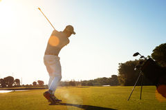 Golf player hitting shot with club Stock Photography