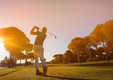Golf player hitting shot with club Stock Photo