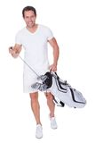 Golf Player Holding Bag With Clubs Royalty Free Stock Photography