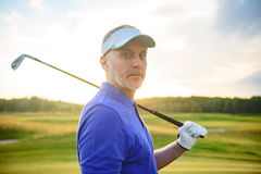 Golf player holding driver Stock Photography