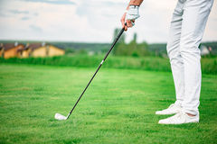 Golf player holding driver Stock Photos