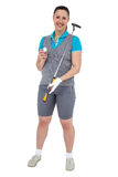 Golf player holding a golf club and golf ball Royalty Free Stock Image