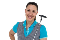 Golf player holding a golf club. Portrait of golf player holding a golf club on white background Royalty Free Stock Photography