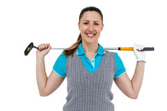 Golf player holding a golf club. Portrait of golf player holding a golf club on white background Royalty Free Stock Images