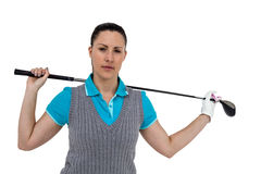 Golf player holding a golf club. Portrait of golf player holding a golf club on white background Stock Photo