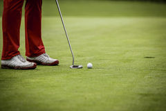 Golf player at hole Royalty Free Stock Photos