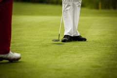 Golf player at hole Royalty Free Stock Photography