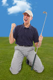 Golf player on knees with club in hand Stock Photo