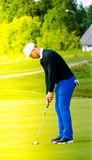 Golf player making the putt Royalty Free Stock Photography