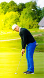Golf player making the putt Royalty Free Stock Images