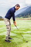 Golf player in the morning Royalty Free Stock Photo